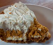 pic of whipping  - Whipped pumpkin pie slice with whipping on top - JPG