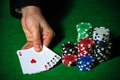 stock photo of flush  - Flush in poker and betting chips on green cloth - JPG