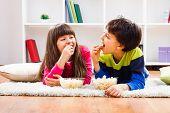 Children eating popcorn
