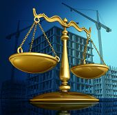 stock photo of architecture  - Construction law concept as a justice scale over a working building site with cranes and a structure being built as a concept for architecture permits and real estate regulations - JPG