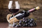 Winery Background. Wineglass With Bottle Of Red Wine And Cluster Of Grape