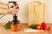 stock photo of blender  - Hands chefs shreded vegetables in a blender - JPG