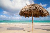 Wooden Umbrella On Empty Sandy Beach