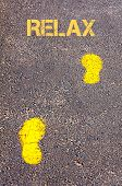 Yellow Footsteps On Sidewalk Towards Relax Message