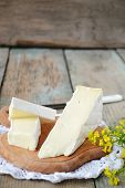 stock photo of brie cheese  - piece of brie cheese on wooden board - JPG