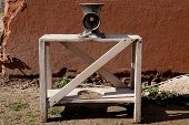 picture of slaughter  - Manual mincer machine over wooden stand - JPG