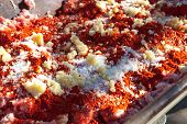 picture of slaughter  - Wooden trough full of ground raw meat covered with spices just before being mixed to getchorizo or sausages - JPG