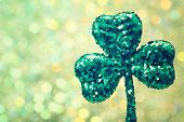 stock photo of saint patrick  - Saint Patricks Day shiny green clover ornament - JPG