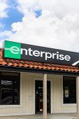 Enterprise Rent-a-car Sign And Store Vertical Image