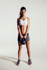 picture of slim model  - Fitness woman doing exercising with kettle bell - JPG