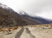 picture of icy road  - Local road in mountain range Ladakh India - JPG