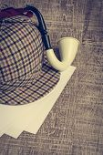pic of sherlock holmes  - Deerstalker or Sherlock Hat and Tobacco pipe on Old Wooden table - JPG