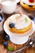 foto of curd  - Mini lime curd tartlets with meringue - JPG