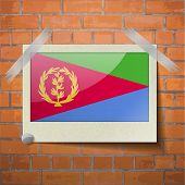 foto of eritrea  - Flags of Eritrea scotch taped to a red brick wall - JPG