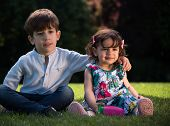 foto of brother sister  - Two children sitting on the lawn - JPG