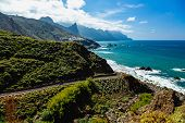 foto of atlantic ocean  - Road near coast of Atlantic ocean with mountains or rocks and blue sky with clouds and skyline or horizon in Tenerife Canary island Spain at spring or summer - JPG