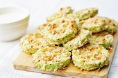 stock photo of crisps  - baked parmesan zucchini crisps on a white background - JPG