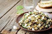 picture of quinoa  - quinoa spinach eggplant feta salad on a dark wood background - JPG