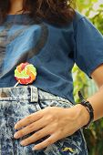picture of texans  - colorful of candy in a jeans pocket - JPG