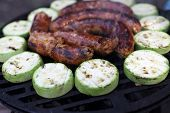 pic of grilled sausage  - Grilled sausages and squash on the barbecue grill
