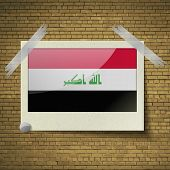 stock photo of iraq  - Flags of Iraq at frame on a brick background - JPG