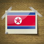 stock photo of north star  - Flags of Korea North at frame on a brick background - JPG