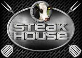 foto of oval  - Oval metal sign with text Steak House head of cow spatulas and forks on a dark metallic grill - JPG