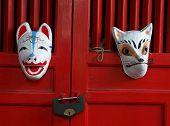 Fox Masks On Red Shrine Doors