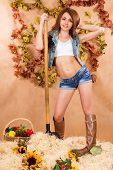 picture of haystack  - Cute young farmer girl working with the pitchfork in a haystack at the background of maple leaves - JPG