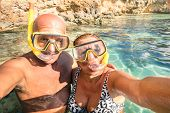 picture of gozo  - Senior happy couple taking a selfie at Blue Lagoon in Gozo and Comino  - JPG
