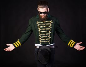 picture of queer  - Magician playing with hat over black background - JPG