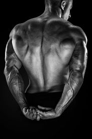 stock photo of bicep  - Handsome power athletic man showing his back - JPG