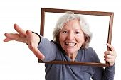 Old Woman Reaching Through Frame