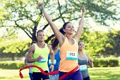 fitness, sport, victory, success and healthy lifestyle concept - happy woman winning race and coming poster