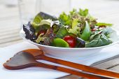 foto of mange-toute  - Healthy salad closeup on outdoor table setting - JPG