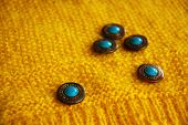 buttons on yellow fabric