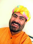 stock photo of rajasthani  - Indian man in colorful rajasthani turban laughing - JPG