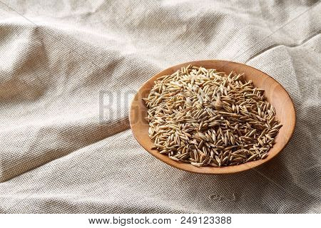 Oat Groats Or Oat Spike In Wooden Plate On Homespun Tablecloth, Copy Space,  Top View, Selective Focu poster