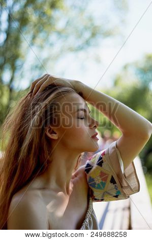 poster of Portrait Of A Red-haired Girl With Long Hair. Hair Down. Artistic Portrait. Child Of Nature. Proximi