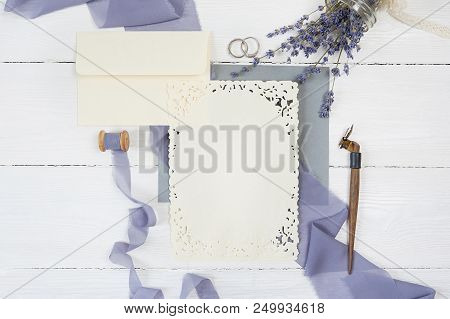 poster of Blank Greeting Card, Envelope And Ribbon With Two Wedding Rings With Lavender Flowers And Calligraph