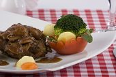 stock photo of chateaubriand  - delicious Tenderloin steak on a table with domato  - JPG