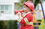 Boy Playing As Fireman Police Occupation In Kindergarten Class, Kid Occupation, Education Concept poster