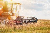 Combine Harvester Agriculture Machine Working In Field Close Up. Parts Of Harvest Machine poster
