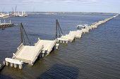 image of katrina  - The old Biloxi to Ocean Springs bridge after hurrican katrina got through with it - JPG