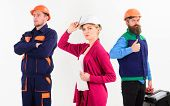 Female Manager Concept. Woman In Hard Hat With Confident Face Stand In Front Of Male Builders In Uni poster