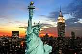 stock photo of new york skyline  - The Statue of Liberty and New York City skyline at dark - JPG