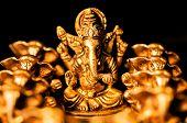 image of laddu  - The Hindu God Ganesha surrounded amongst Ganesha