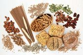 High fiber health food with whole grain bread rolls, whole wheat pasta, nuts, seeds and grains. Rust poster