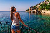 Young Woman Look On Ancient Shipyard From Kizil Kule Tower In Alanya Peninsula, Antalya District, Tu poster