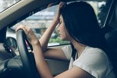 Stressed Woman Driver Sitting In Car Having Headache Stop After Driving Car In Traffic Jam On Rush H poster
